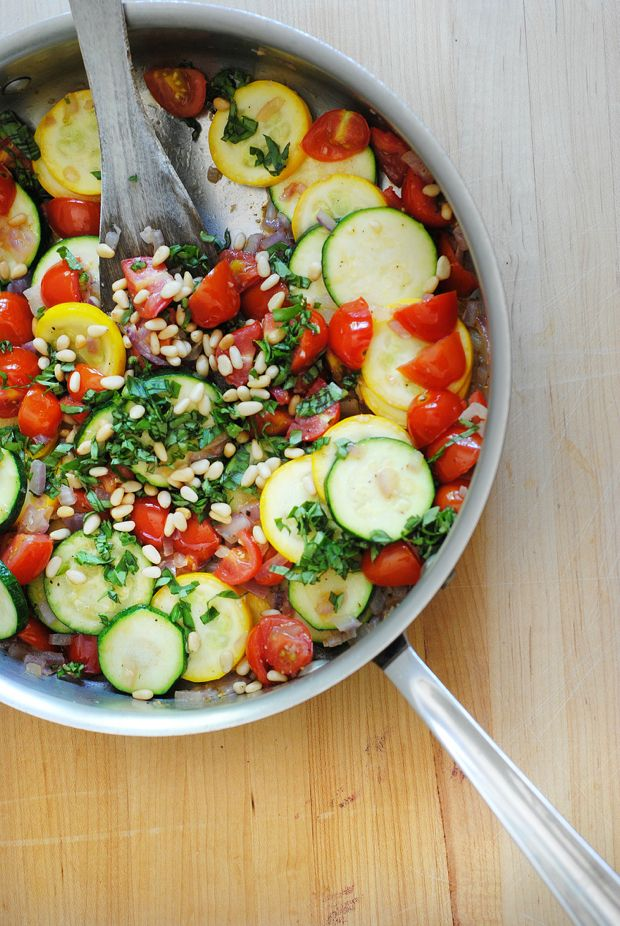 Quick zucchini squash sauté with tomatoes, basil, and pine nuts