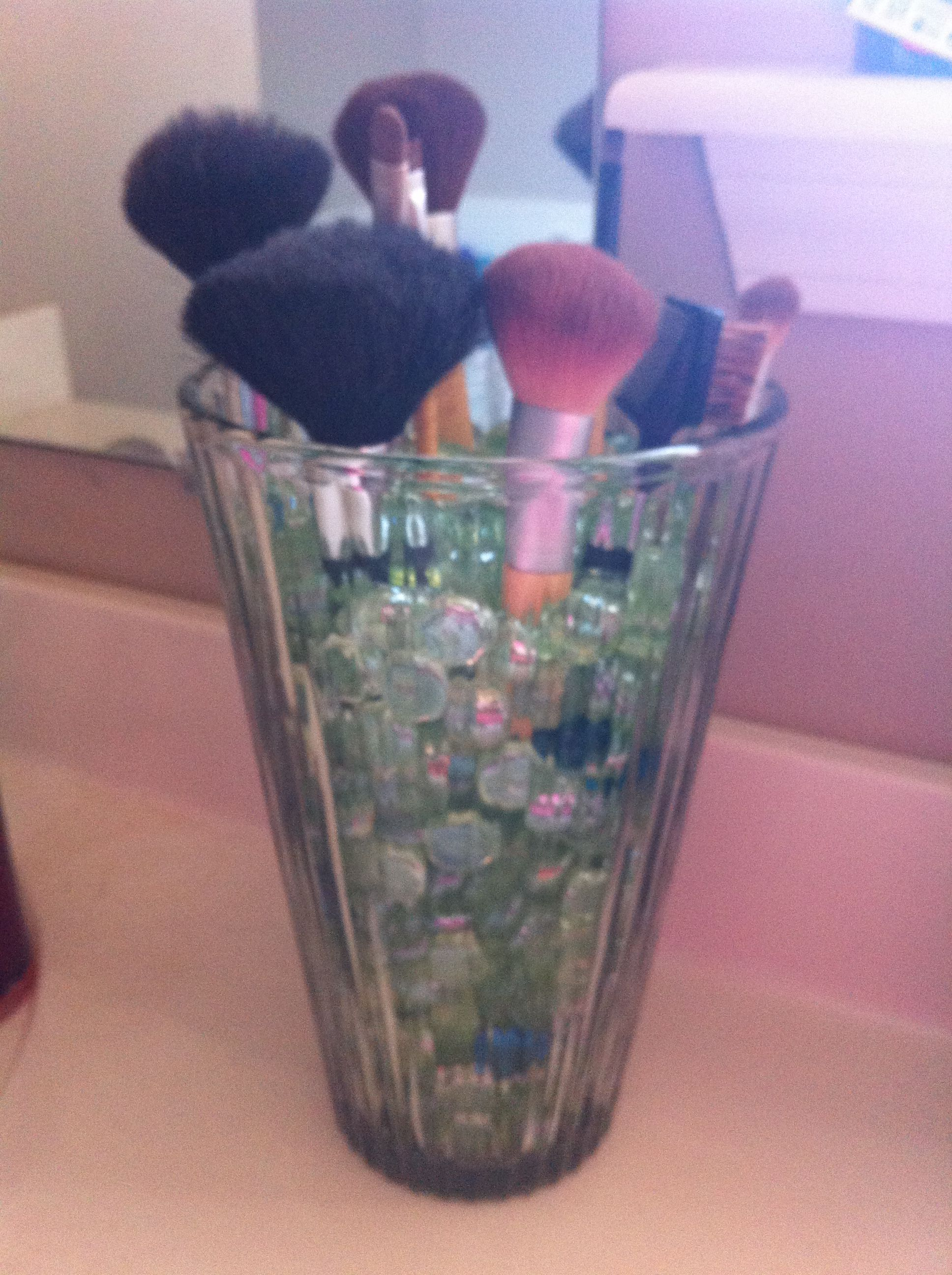 Add a little color to your bathroom and easy access to your brushes all in the same  vase!
