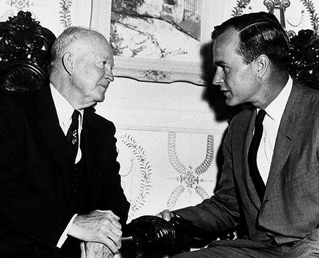 """Pulling off """"Don Draper"""" style, in a skinny tie and grey suit, while meeting Dwight D. Eisenhower. 