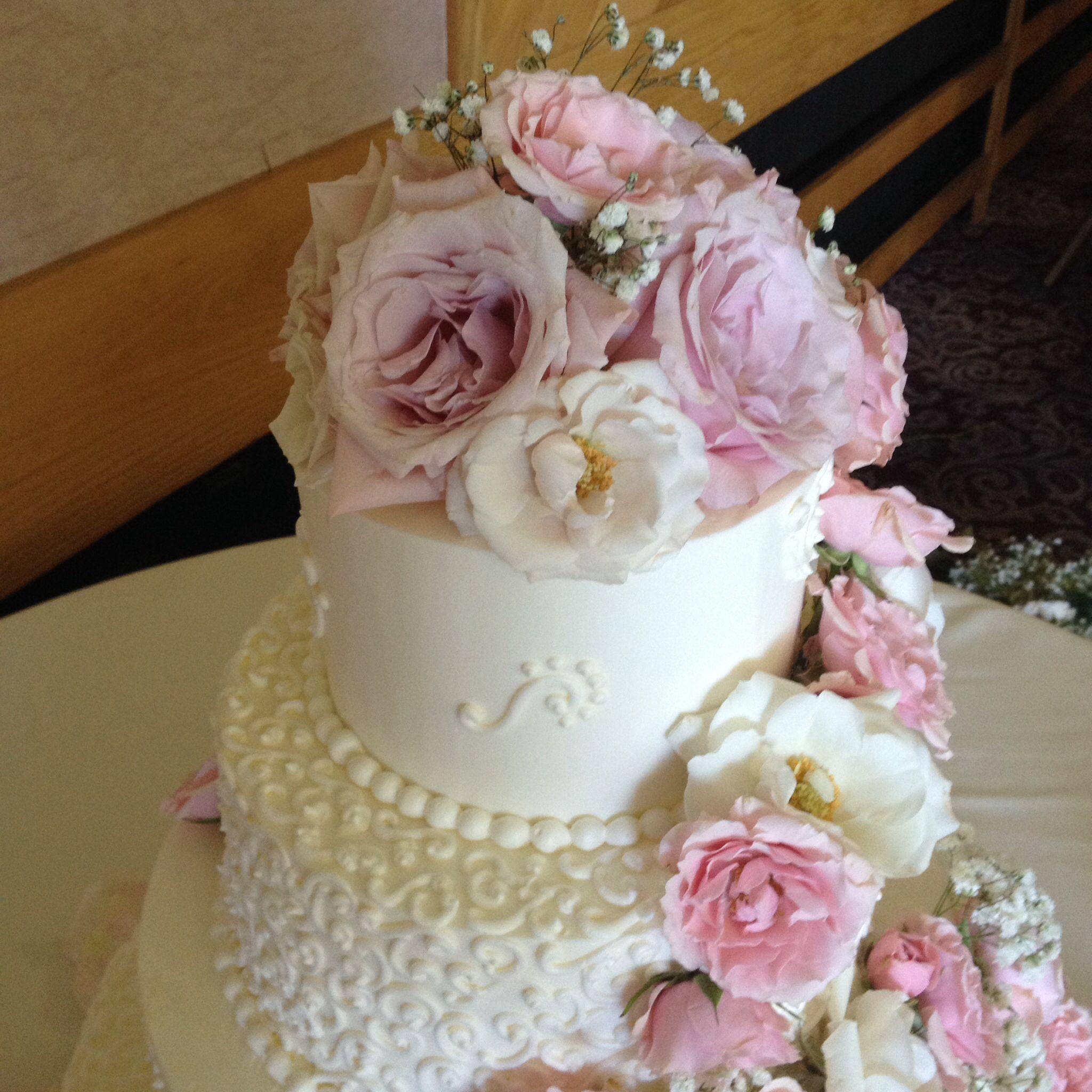 Elegant scroll wedding cake