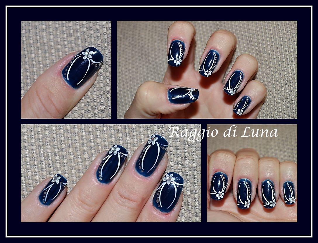 Raggio di Luna Nails: Elegant manicure White flower on dark blue ...