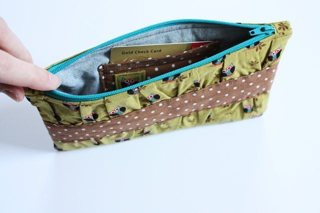 a cute clutch, but more importantly, how to sew zipper end tabs