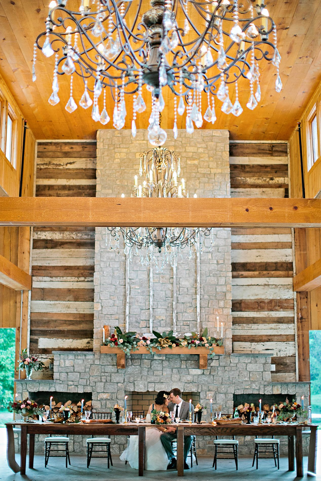 Soaring ceilings, grand chandeliers, stacked stone fireplaces - just a few perfect touches. Photos: Kristyn Hogan | Venue: Homestead Manor | Styling: The Bride Room | Hair: Leslie Ellis | Makeup: Meg Boes | Floral: Amanda Jerkins Design