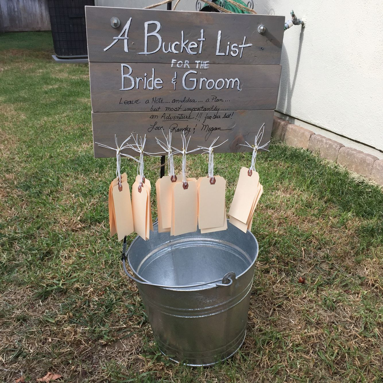 a bucket list for a bridal shower or wedding reception from a deconstructed shipping pallet take a tag and give the new husband and wife some suggestions
