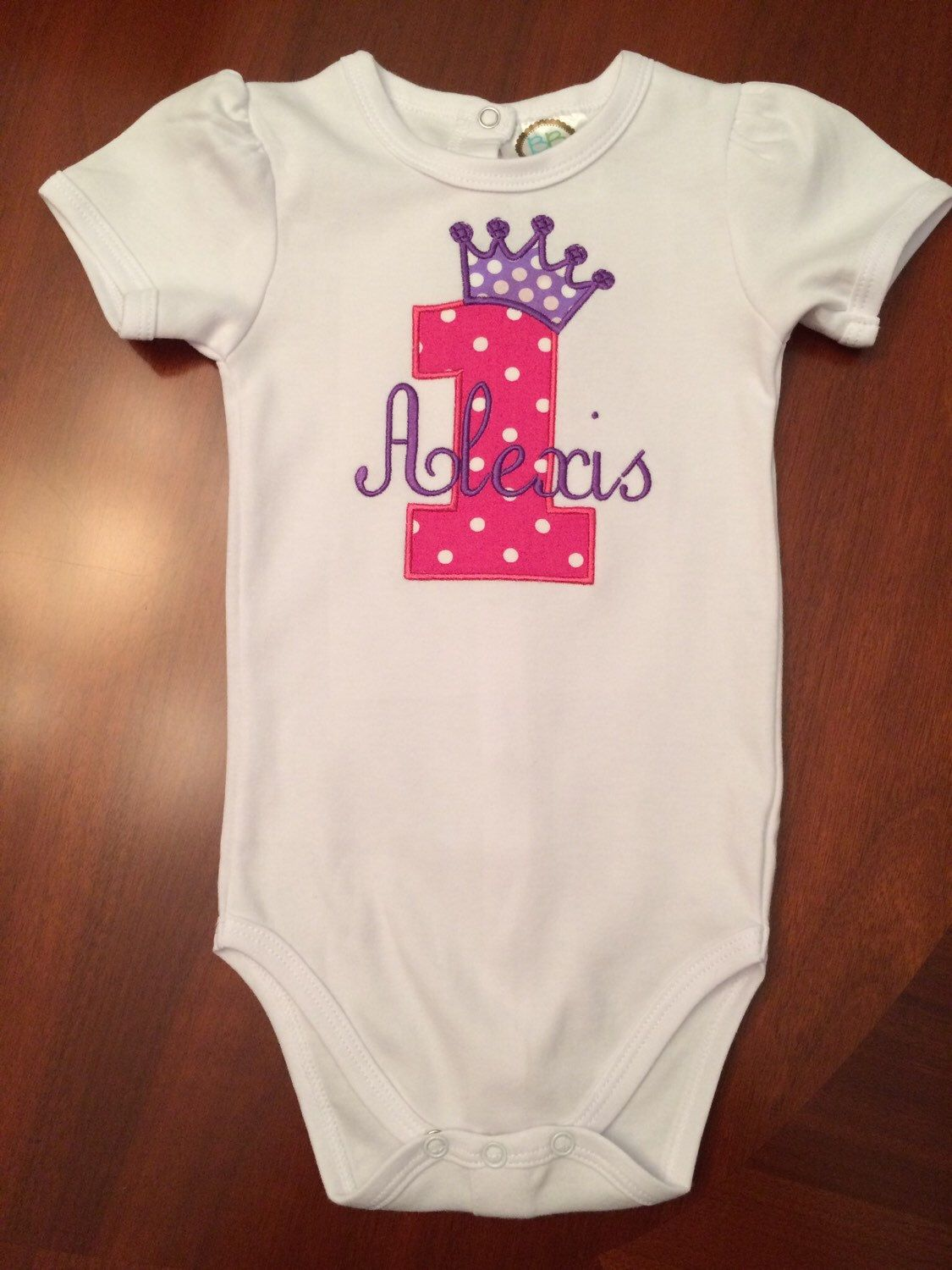 A personal favorite from my Etsy shop https://www.etsy.com/listing/248157604/personalized-birthday-onesie