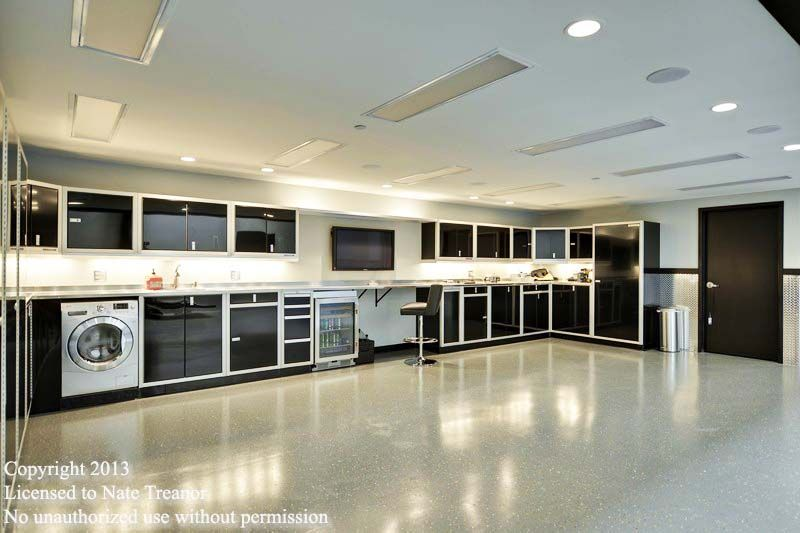 Garage condo in mn that features these moduline cabinets for Condo plans with garage