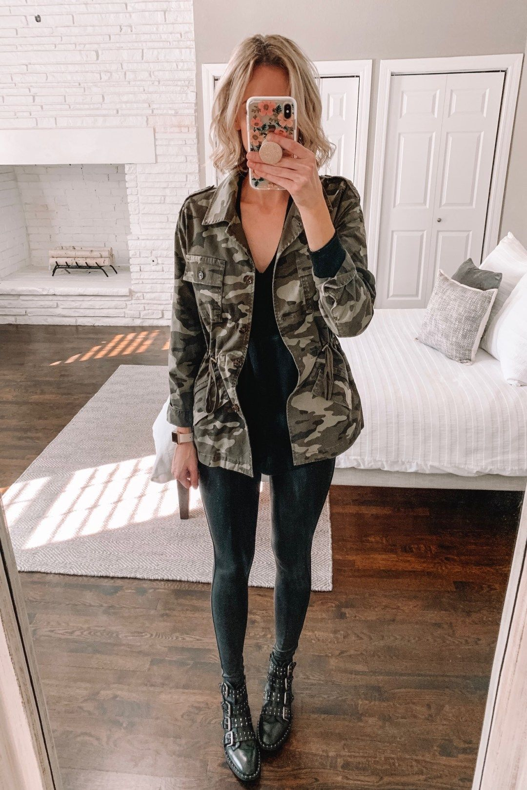 e4c1875df220b How to wear leggings casually faux leather leggings with a long layering  top camo jacket and
