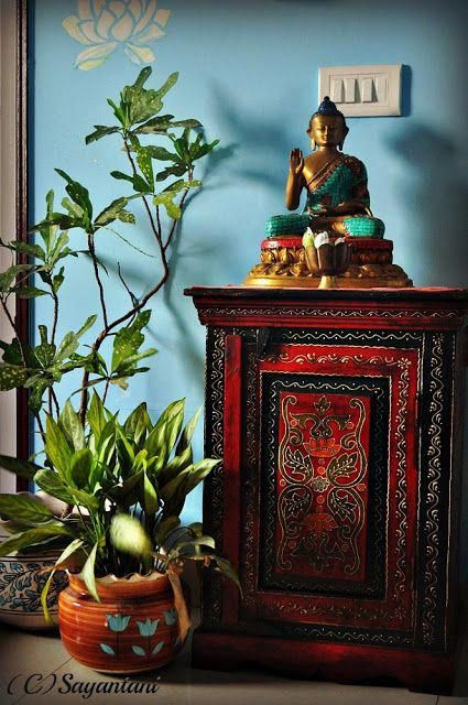 colourful combo of red cabinet with blue background and a buddha statue #BuyingList #buddhadecor