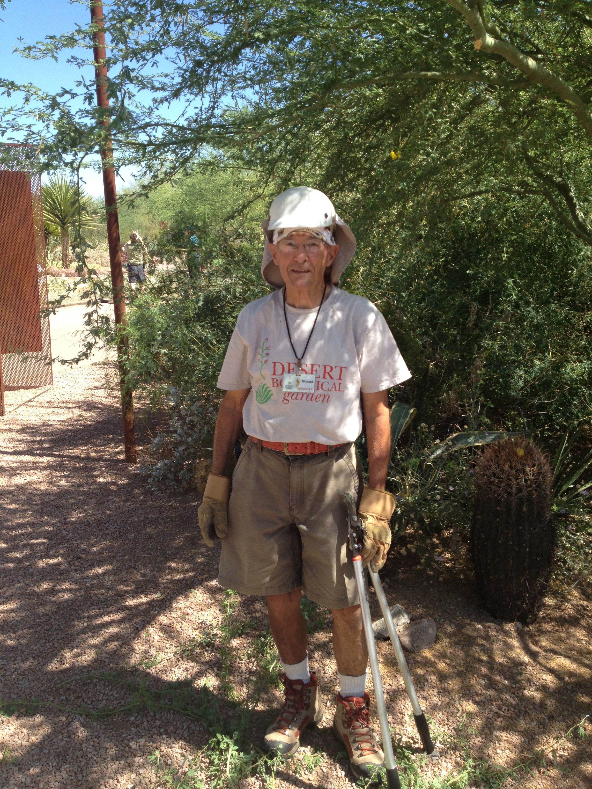Richard, a garden volunteer, wears a hat and bandana to stay out of the hot summer sun!