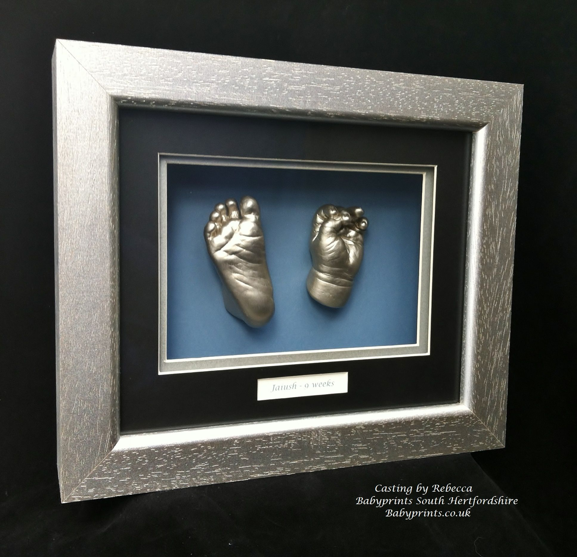 Striking silver baby hand and foot casts in a contemporary silver ...