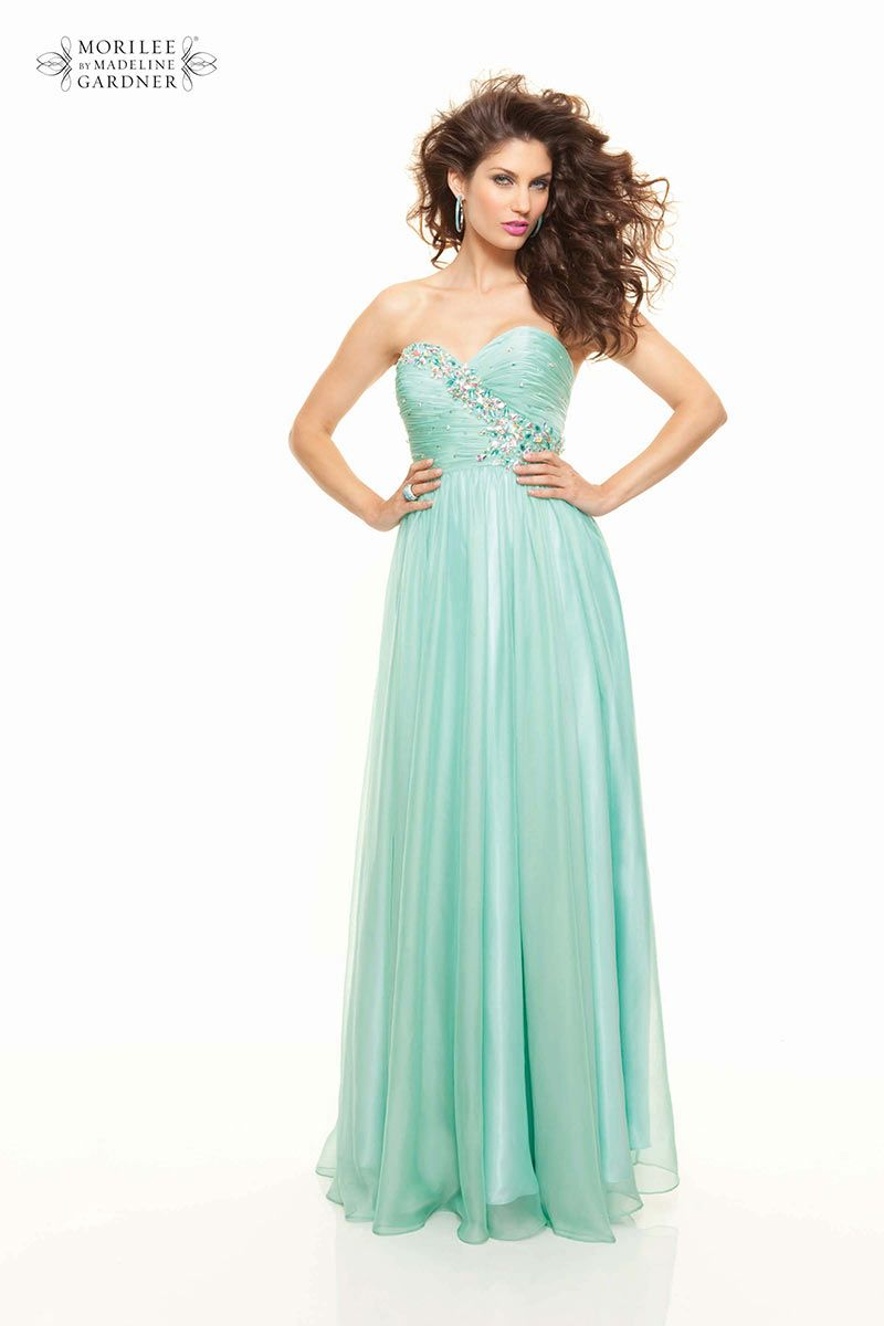 The mint green grecian prom dress from mori lee has a stunning