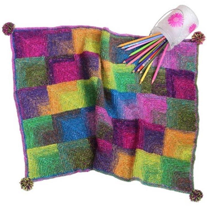 Mitred corner knitted blanket