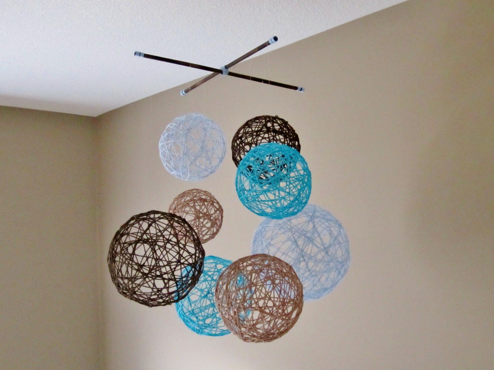 """Yarn around balloons Elmers glue! Could make these with a small opening in the top, and use as """"vases"""" for the centerpieces, filled with a few fake flowers! Quick, inexpensive and easy!! Could even do this as a craft with the mommies."""