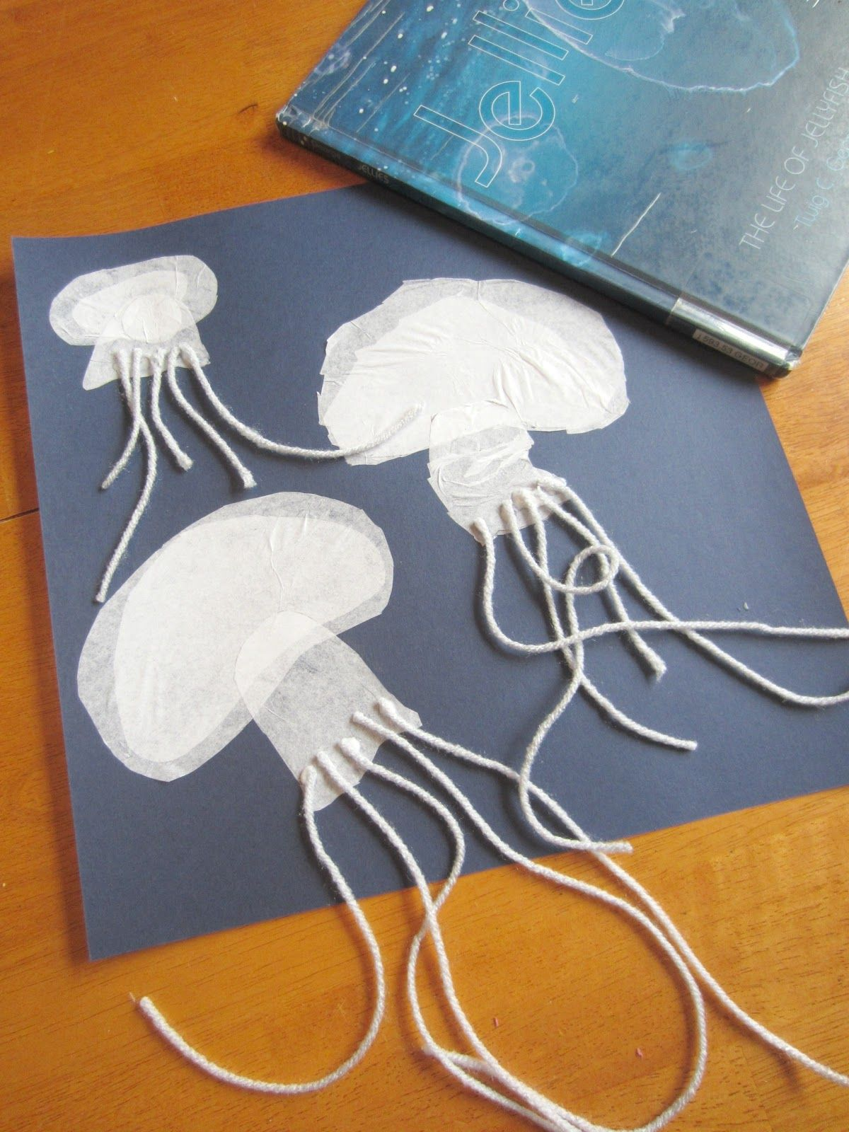 J for Jellyfish Art & Write. Use patterns to cut the bodies of jellies from tissue paper, layer, and glue. Attach yarn for stingers. Download patterns and a writing page at Relentlessly Fun, Deceptively Educational.