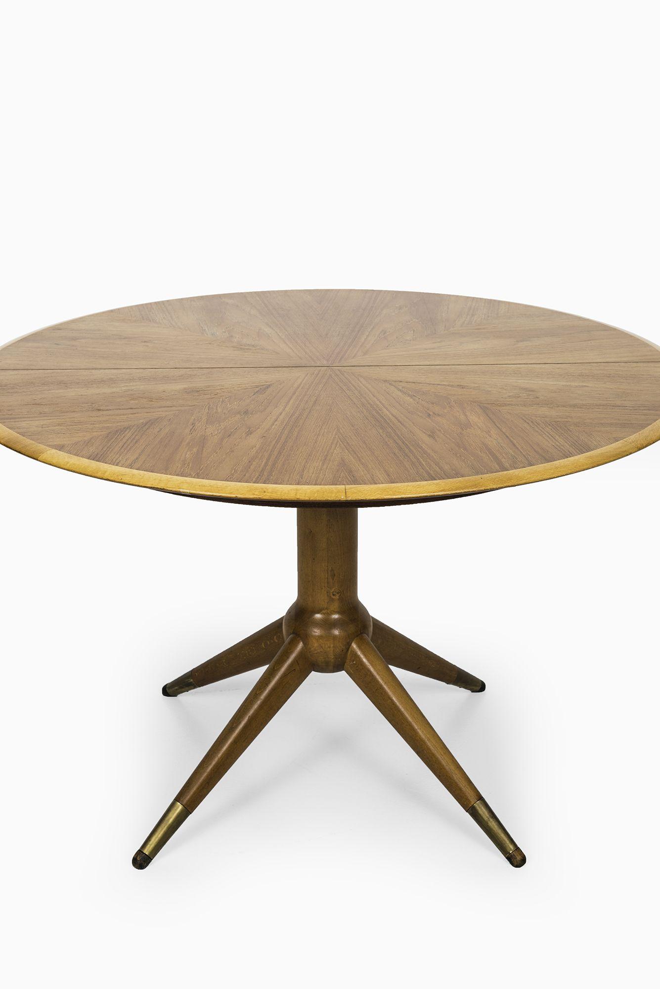David Rosén dining table in teak, beech and brass at Studio Schalling