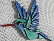 Mosaic Hummingbird on net self-laying