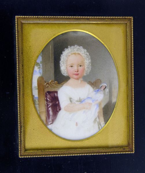 Thomas Heathfield Carrick, circa 1840 A charming portrait of a little girl seated on a chair with red leather upholstery, wearing a white dress lace bonnet and cradling a doll on her lap Painted on marble, set in gilt mounted rectangular black wood frame    Dimensions: Oval, 5 inches high (excluding frame)