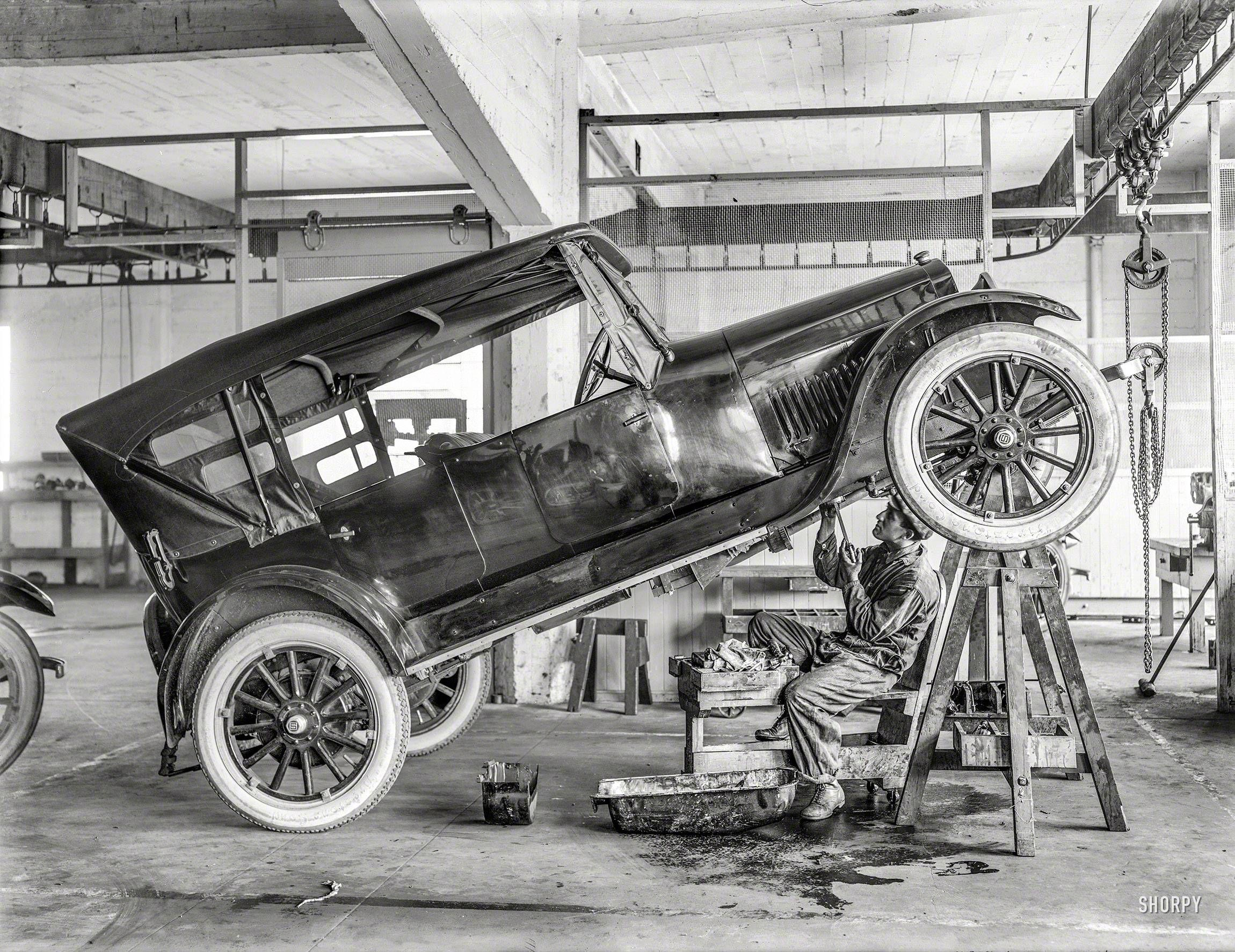 Car interior restoration jacksonville fl - Mechanic Working On An Old Studebaker In Repair Shop C 1919