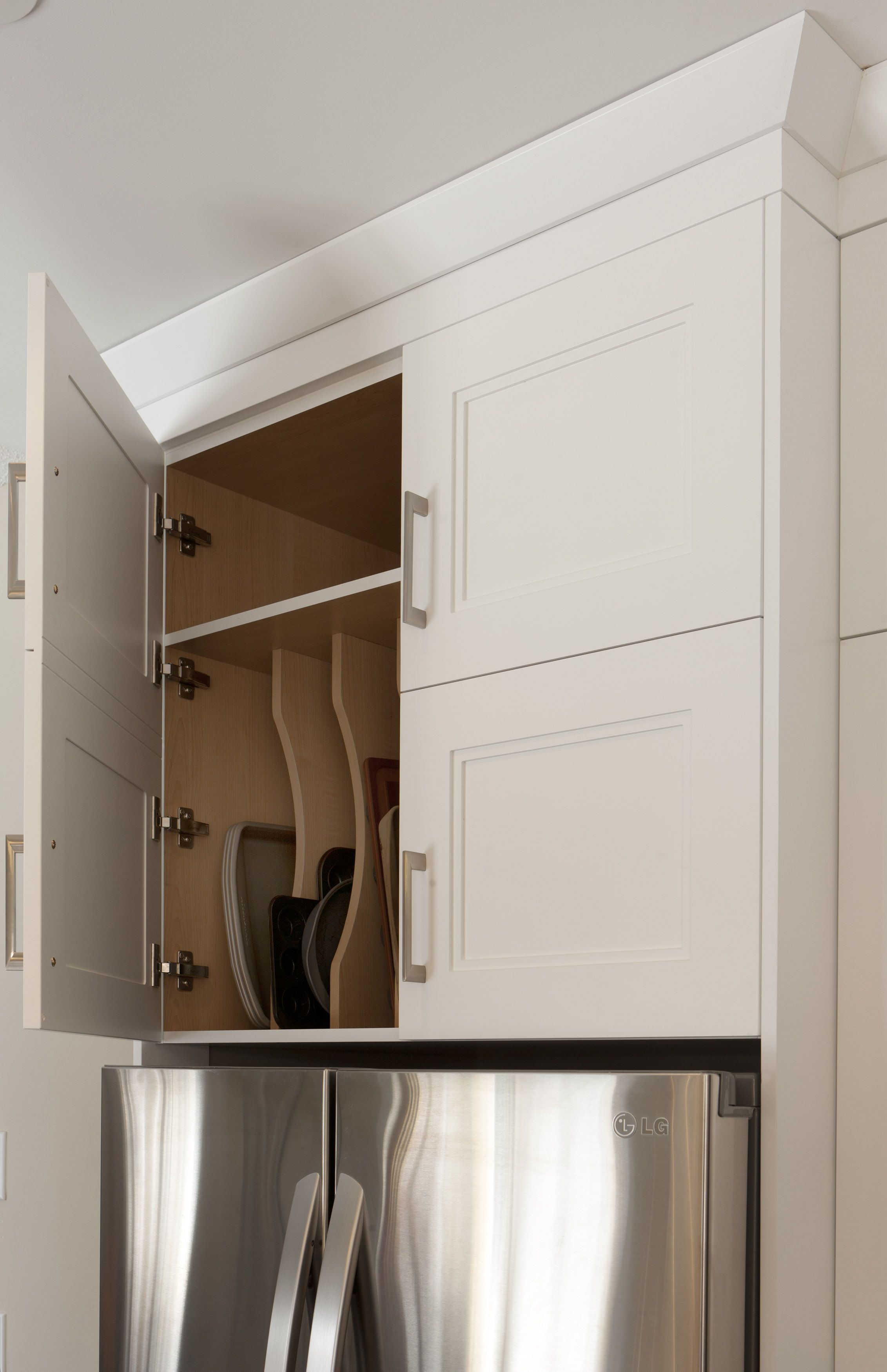 Tray Storage Above the Fridge- Easy and Accessible #ChervinKitchen