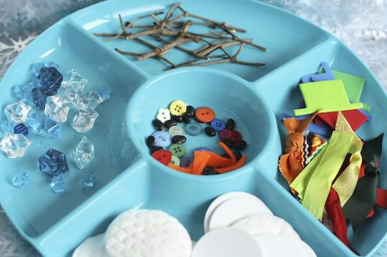"""Create a snowman activity tray with cotton will pads or white craft foam circles, small lengths of ribbon/trim/fabric, craft foam or cardstock or felt (for hats), buttons, dried black beans, plastic ice crystals, triangular pieces of orange felt  small twigs - from happy hooligans ("""",)"""