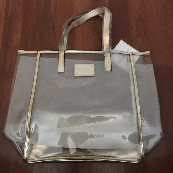 dbefd24446ad42 Brand New MK clear and gold tote Brand new. Never used. MK Clear and gold  tote. NO TRADES Michael Kors Bags Totes