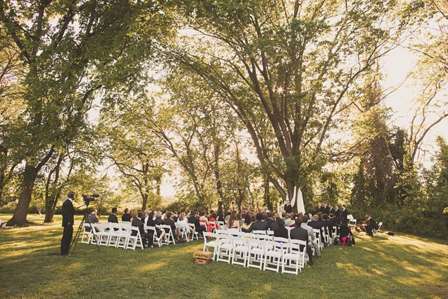 Wedding Ceremony In Front Of Large Tree Next To Reception Tent At Woodlawn Manor