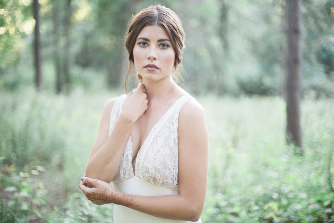 In the woods with a vintage dress - natural hair and makeup on a lovely bride.
