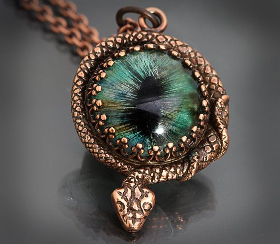 Unisex Snake Eye Necklace Snake Necklace Steampunk: a beautiful solid brass coiled snake wraps around an evil eye or snake eye. The snake eye or