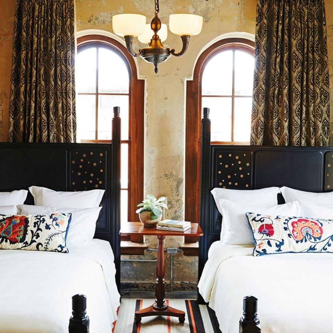 Bedroom At Hotel Emma In In San Antonio Texas Linens Pillows Dark Bed Frame Hotel Emma San Antonio Hotel Emma Chic Home