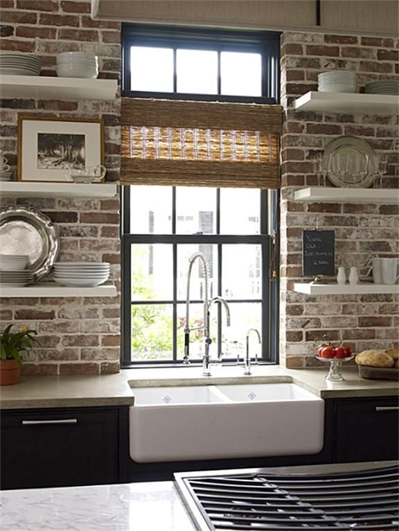 exposed brick kitchen backsplash with open shelving over apron sink and gray cabinets - Kitchen Expos