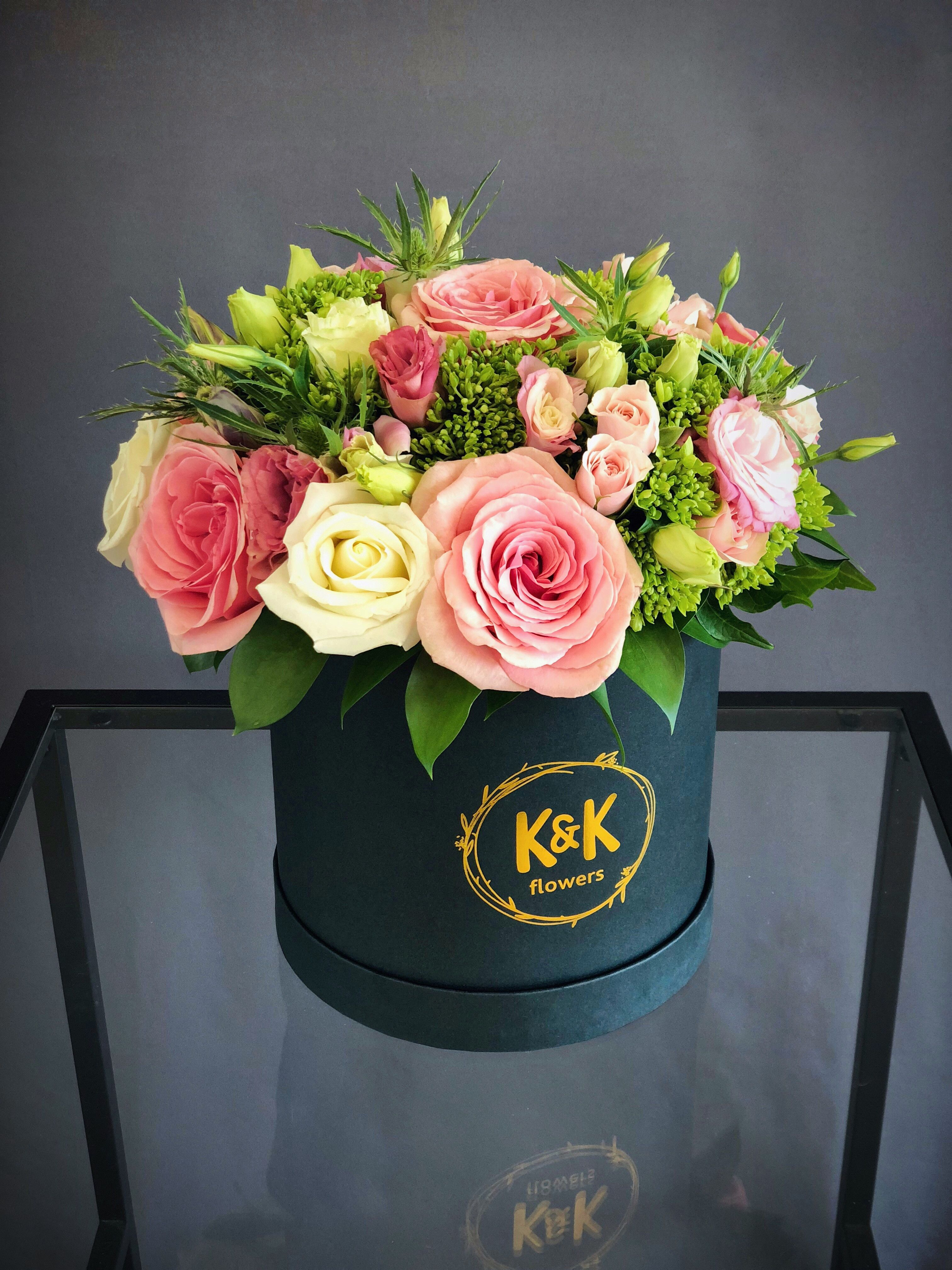 Small hat box with pink and white roses, eustomas and