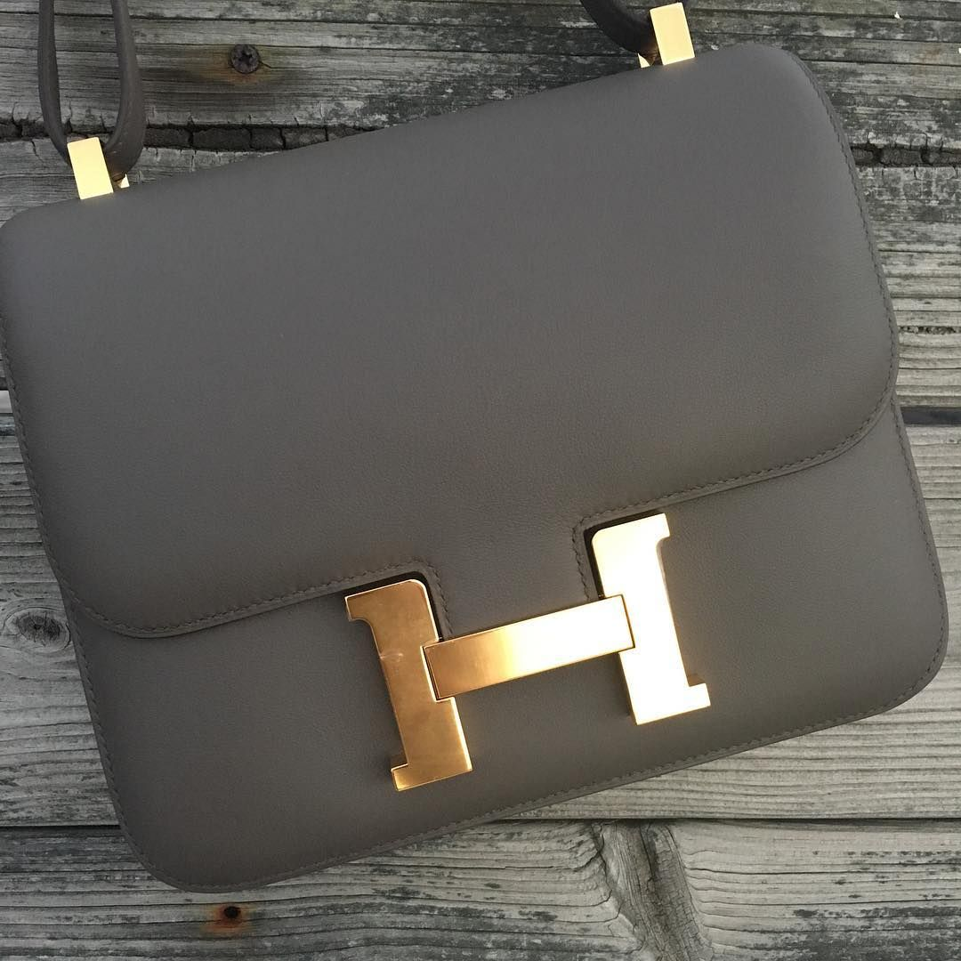 0d6f51225aec Hermes 24cm Constance in etain swift leather with gold hardware ...