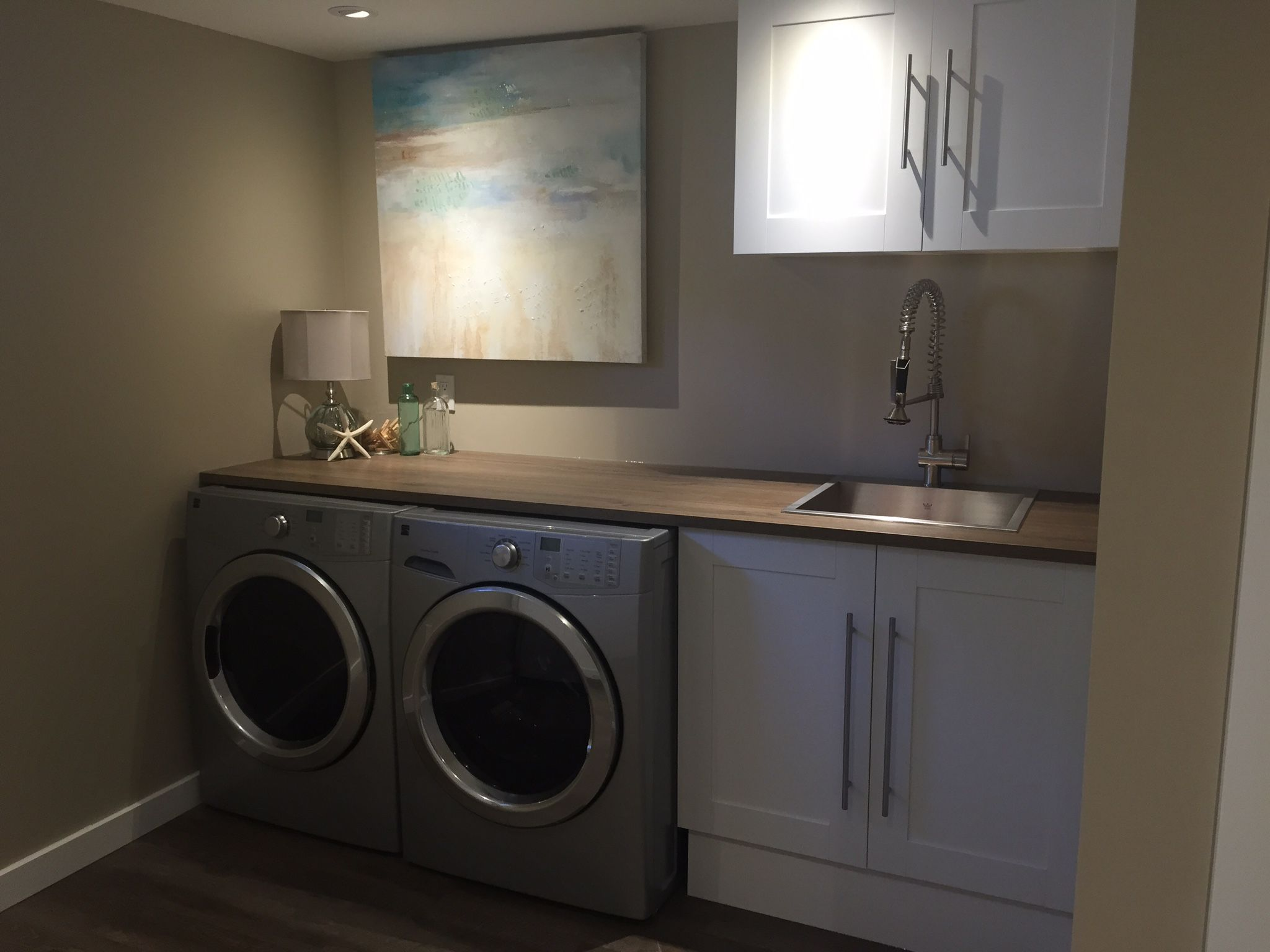 Laundry room Hide electrical panel behind a canvas
