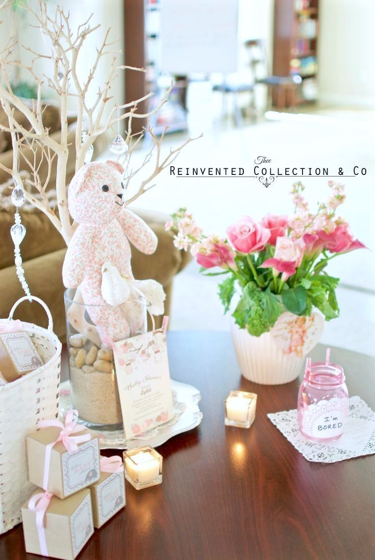 Baby shower decor idea for greeting table at the entry. Styled with favor  box ideas, votive candles, floral arrangement centerpiece ideas and much  more.