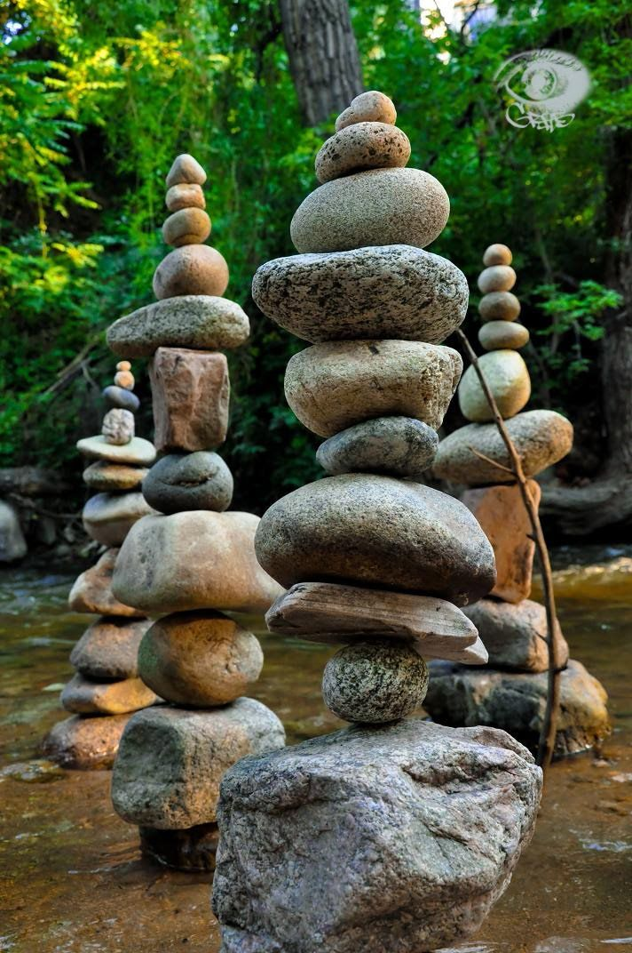 """BOLDERITES"" Rocks set carefuly one upon another in a mountain stream demonstrate the physics of balance."