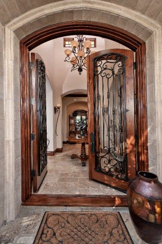 Old World Accents At Double Door Entryway Simple But Elegant Welcome Mat Beautifully Rich Tone Oversized Urn