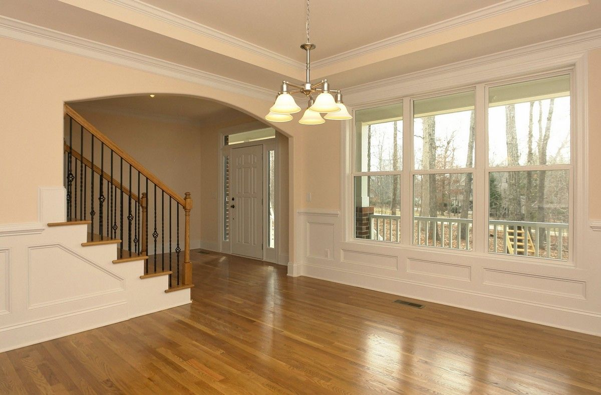 Formal Dining Room Just Inside The Foyer White Front Door With Transom Windows Stained