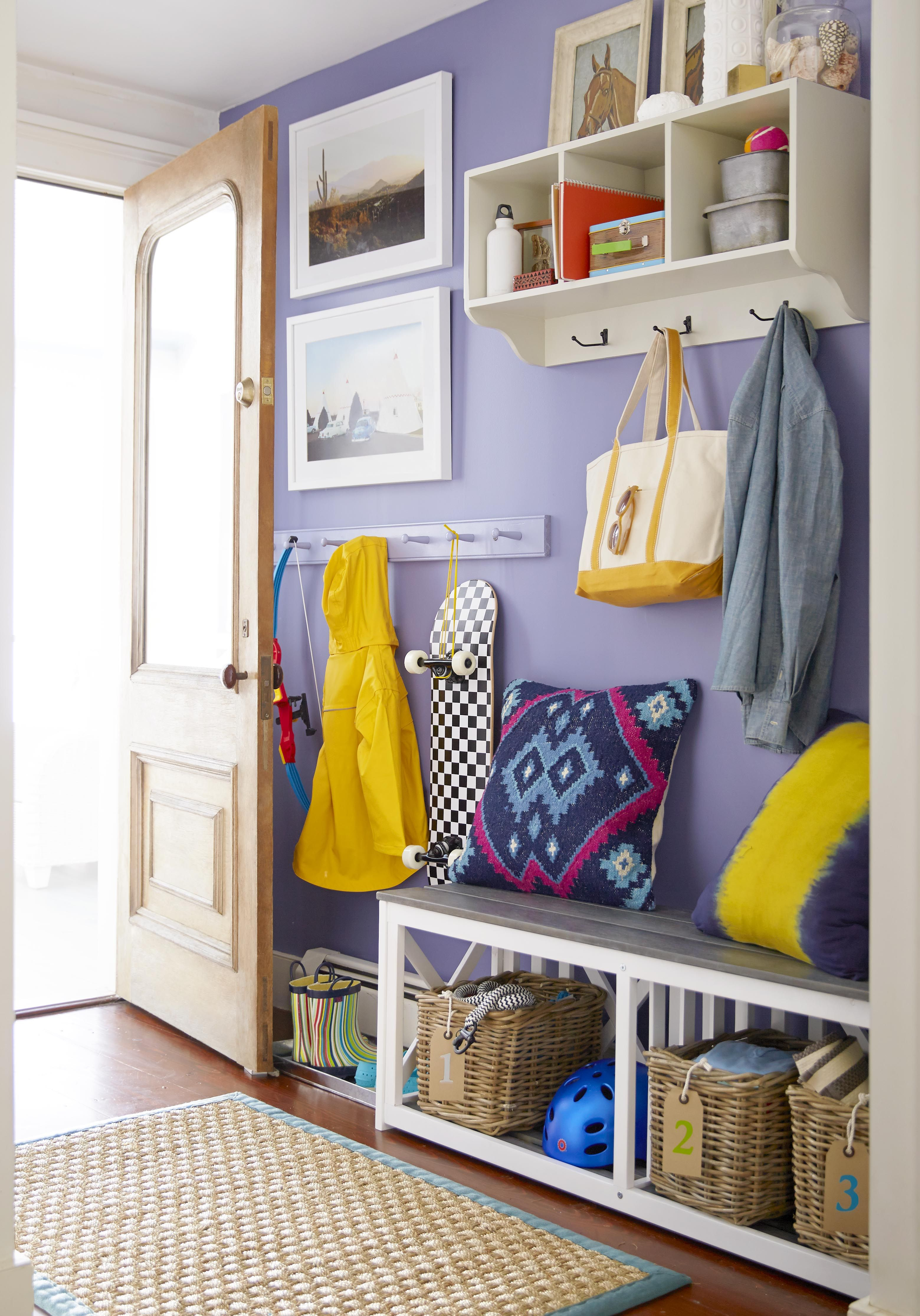 A bench wall mounted cubbies and a slim