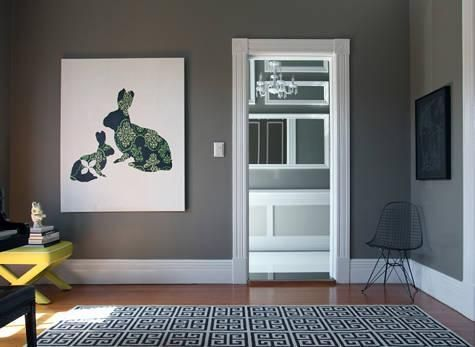 living rooms - Behr - Squirrel - gray taupe brown yellow Jonathan Adler  x-bench geometric black white Greek key rug rabbit art dark gray walls paint  color ...