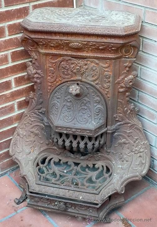 Estufa salamandra de hierro fundido con filigranas en - Estufa de hierro ...
