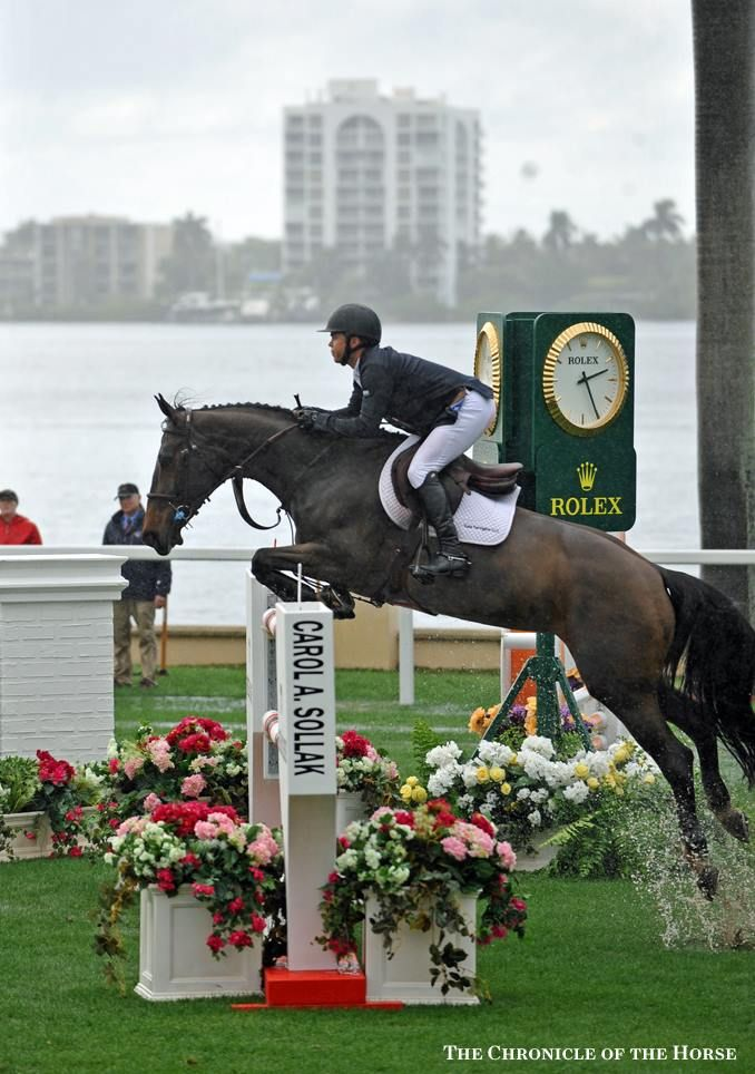 Kent Farrington & 'Blue Angel' win the 125,000 Trump Invitational Grand Prix. The Chronicle of the Horse