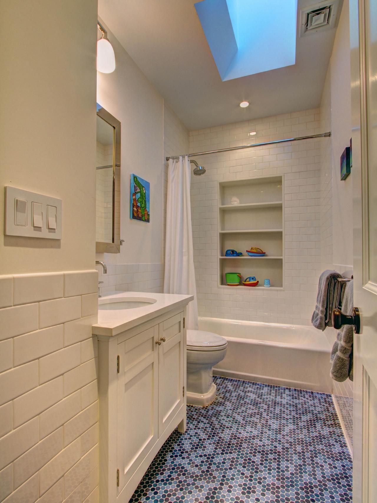 This childrens bathroom features a shower with built in shelves this childrens bathroom features a shower with built in shelves made from white caesarstone doublecrazyfo Images