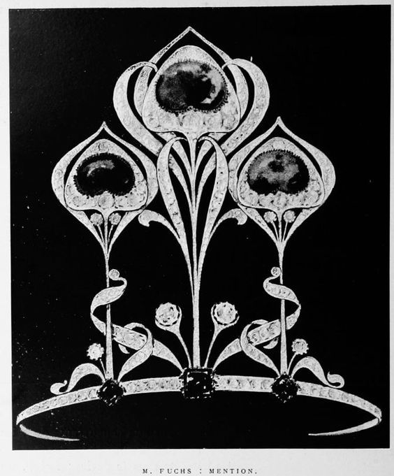 An art nouveau tiara with three large diamond peacock feathers, with central cabochon emeralds, and ribbon scrolls, plus another three emerald at the base