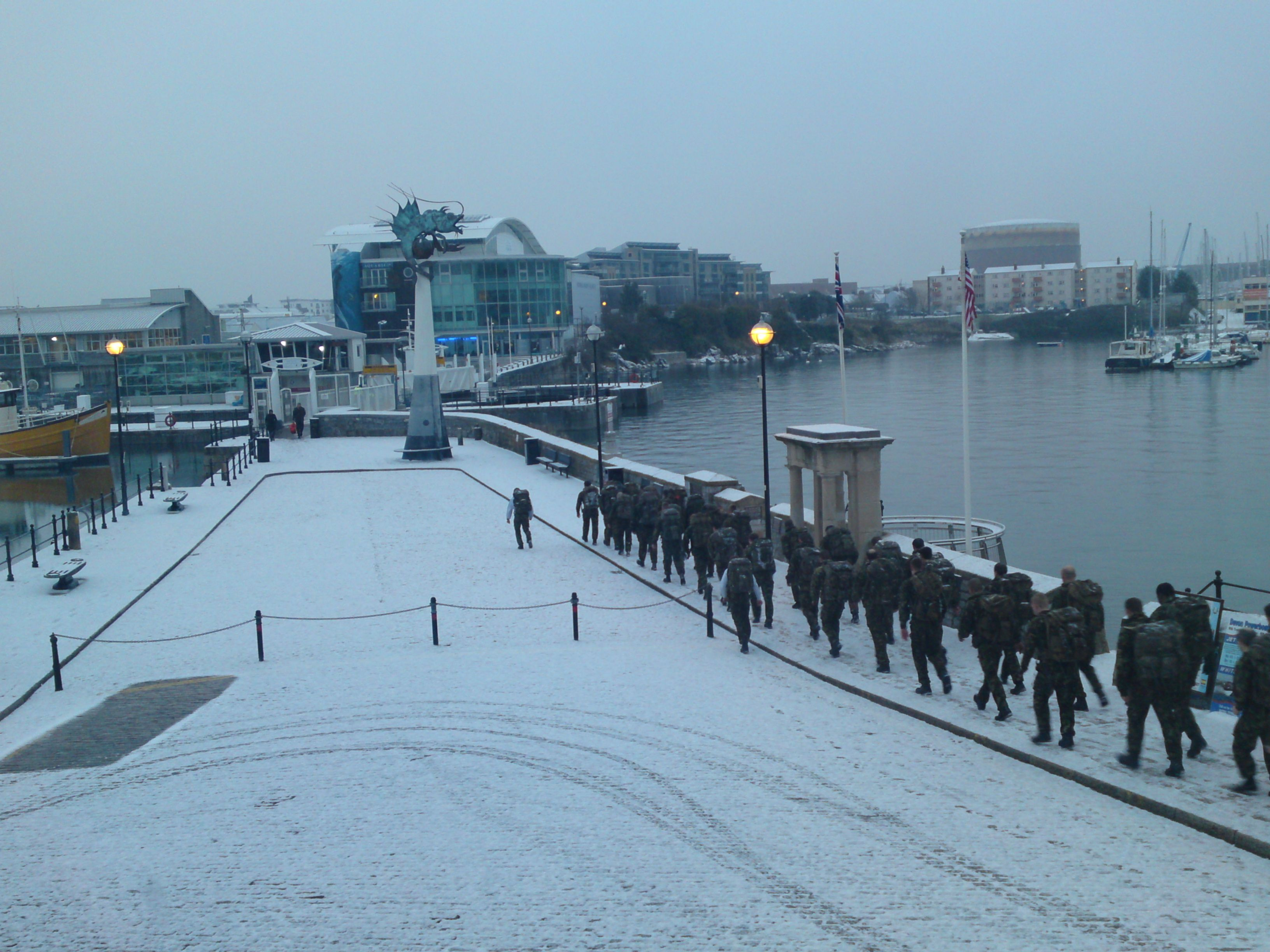 Royal Marines training during snow fall on Plymouth Barbican 2011
