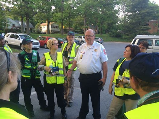 Division Chief Hinde conducts a 'hot wash' with the CERT team after the drill in Rockville.