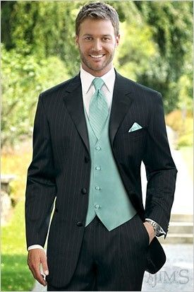 efe6155b153 black tux with vest &(red tie and red rose infront of lapel?) ours would be  light blue maybe