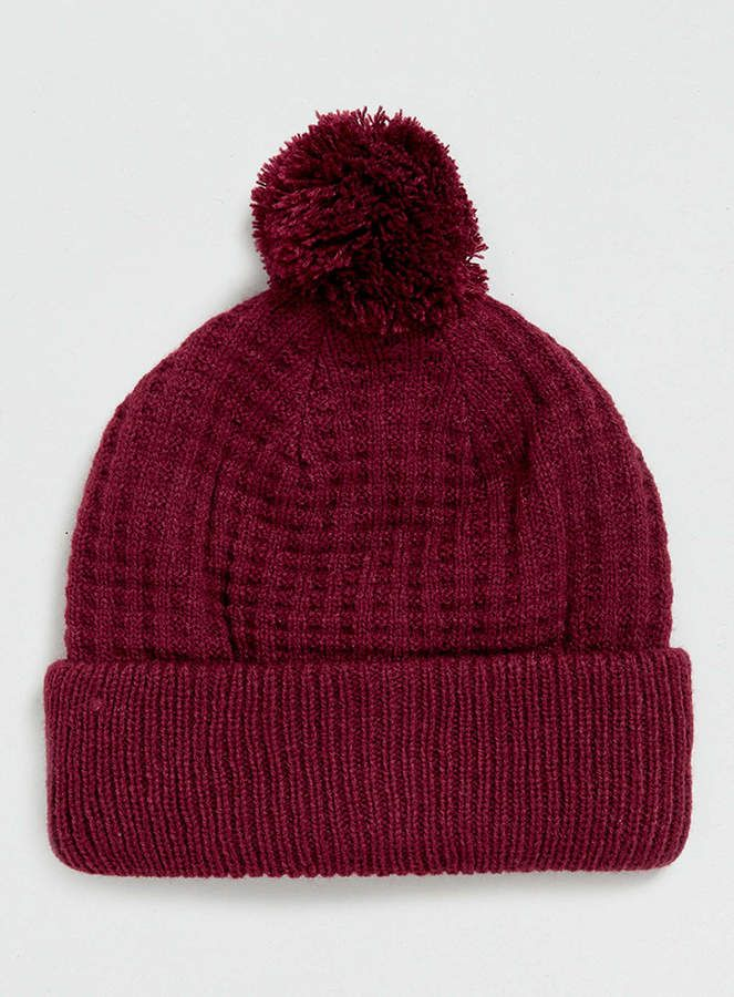 $20, Burgundy Beanie: Topman Burgundy Bobble Beanie. Sold by Topman. Click for more info: https://lookastic.com/men/shop_items/101031/redirect
