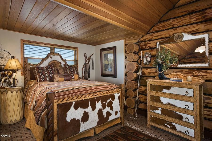 Love this western rustic cabin decorated in cowhide ...