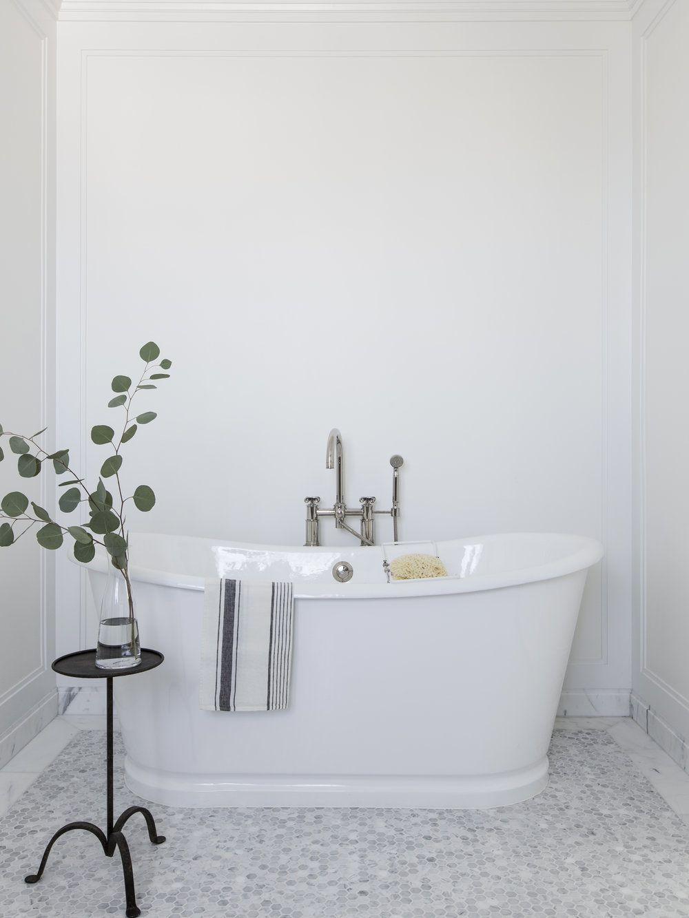 All white bathroom design with stand alone white tub and hex tile ...