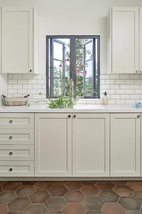 Ivory Laundry Room Clad In Terracotta Hexagon Floor Tiles Features